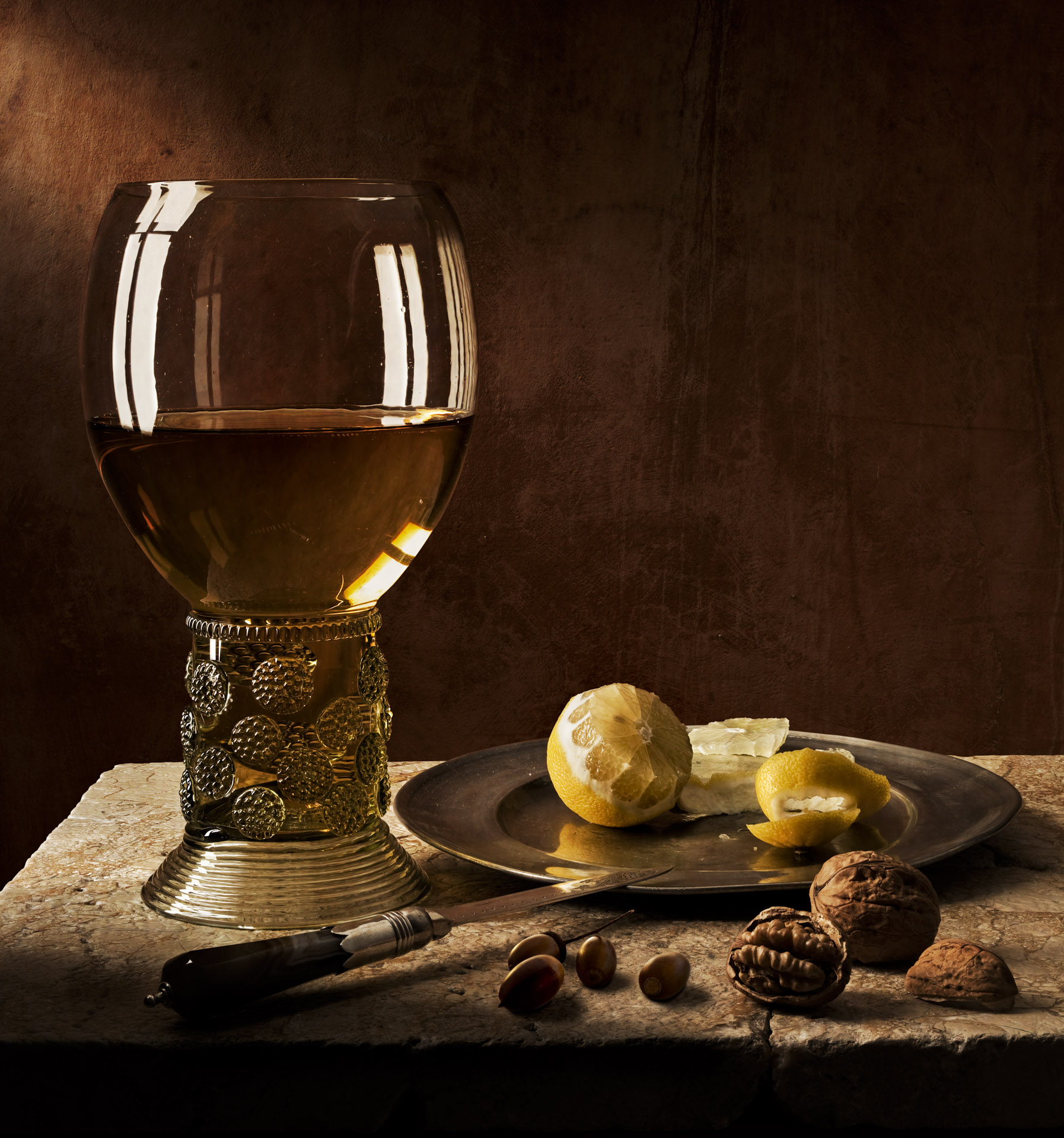 Still life with Roemer, nuts and lemon