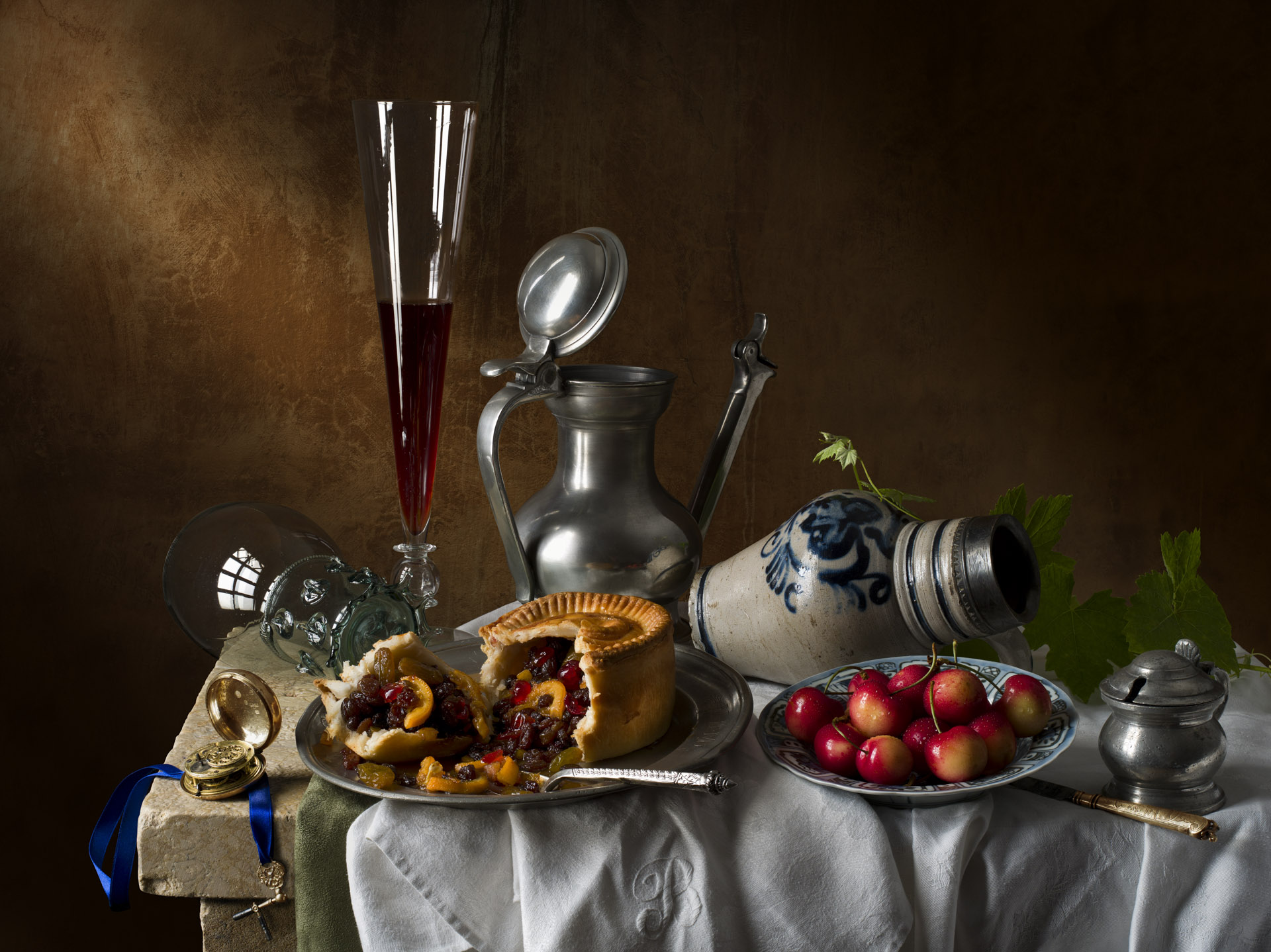 Still life with fruit pie and cherries