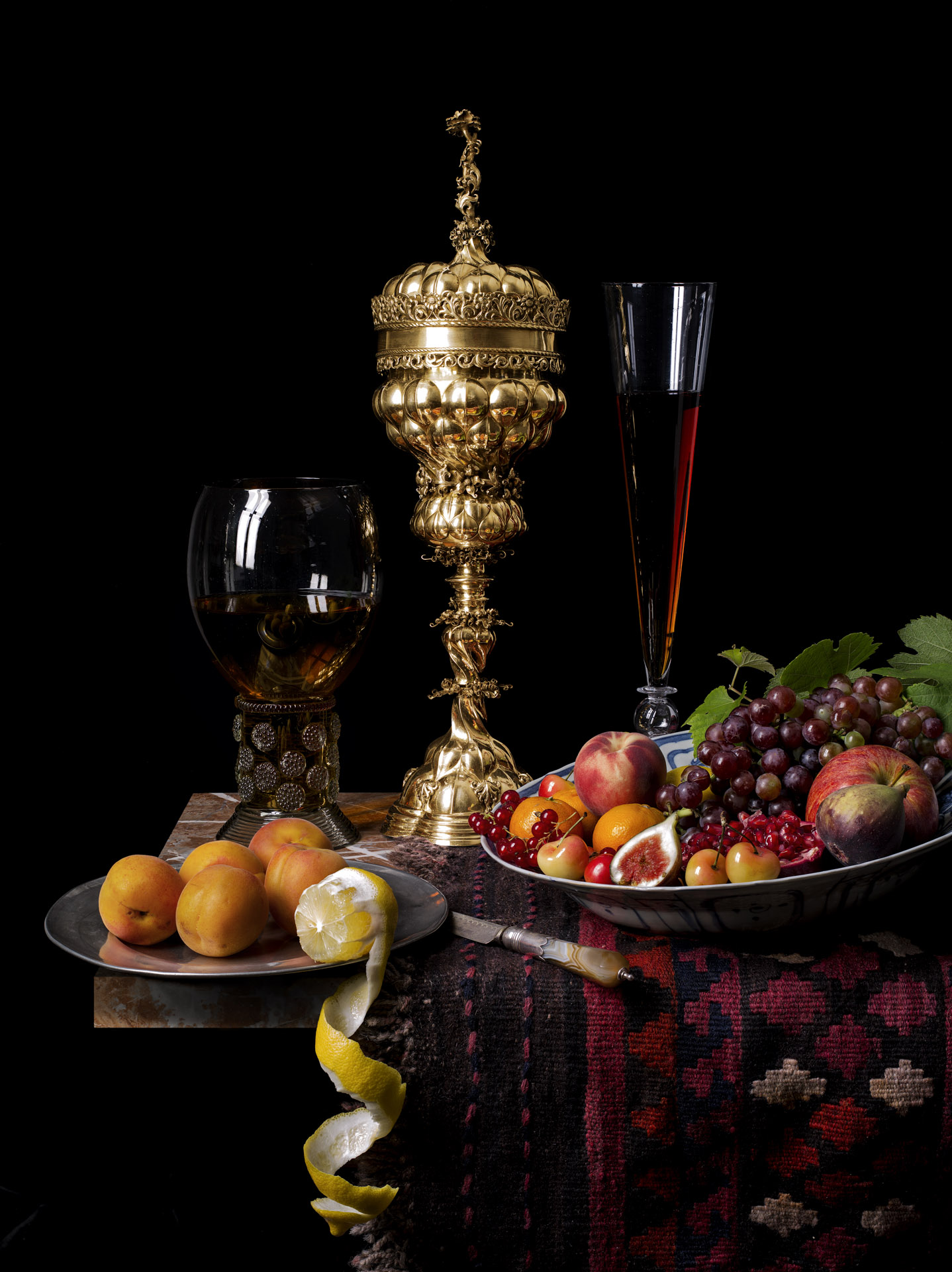 Still life with covered cup and flute glass