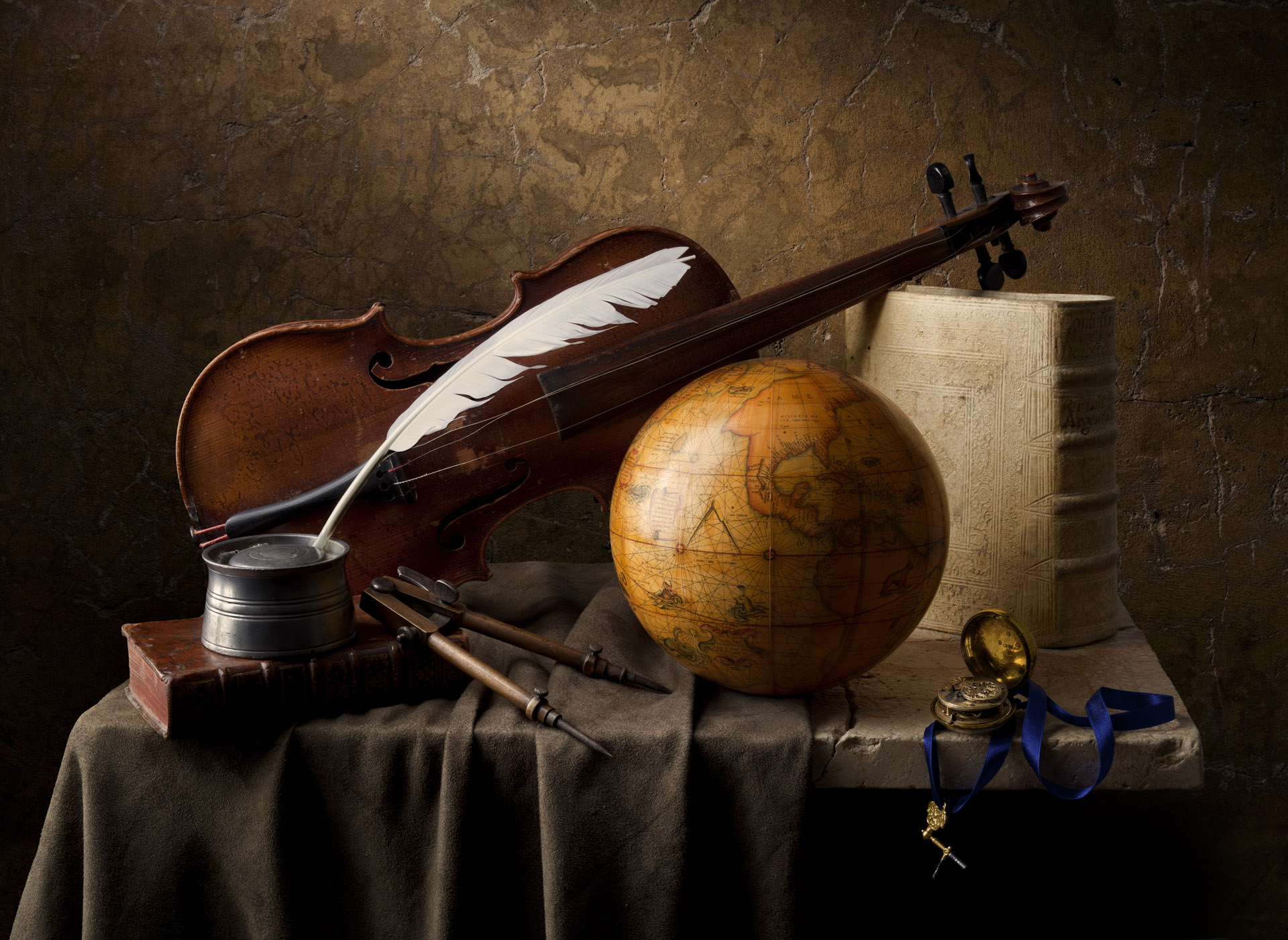 Still life with quill and globe