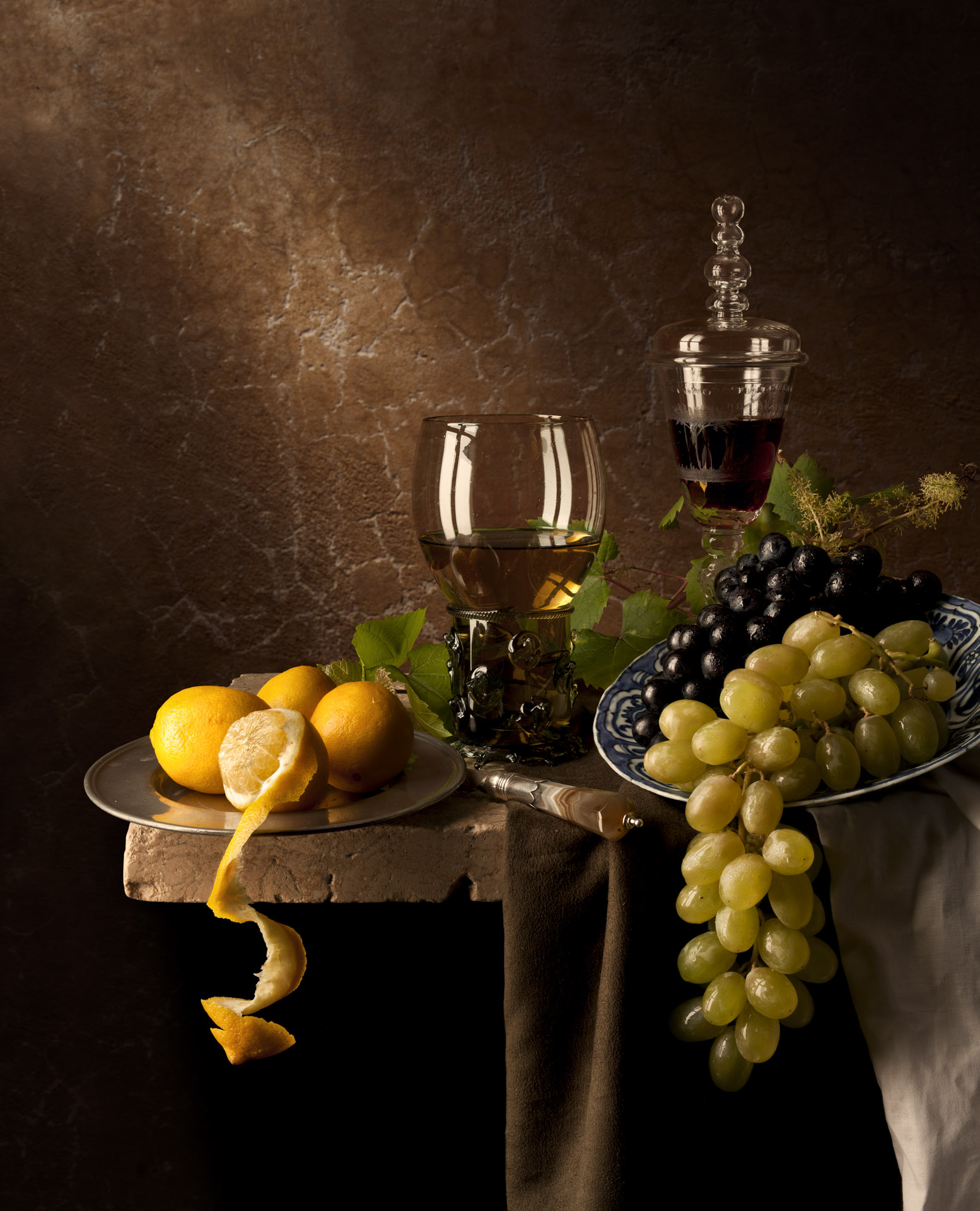 Still life with grapes and lemons